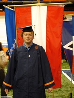 Commencement photo with Austrian flag in background